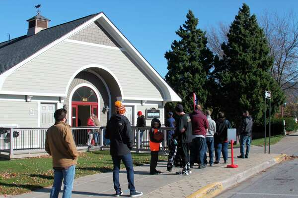 Manistee voters lined up outside the Municipal Marina Building to vote in the Nov. 3, 2020 election.The city Election Commission has recommended changing the current polling location; Manistee City Council will discuss the matter at 7 p.m. on Tuesday.(File photo)