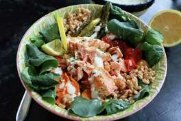 A grain bowl with roasted veggies and lemon-garlic salmon is a great way to kick off fish Fridays for Lent. (Gretchen McKay/TNS)