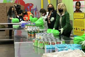 First Lady Dr. Jill Biden packs food as she visits the Houston Food Bank Wednesday, Feb. 262021, in Houston.