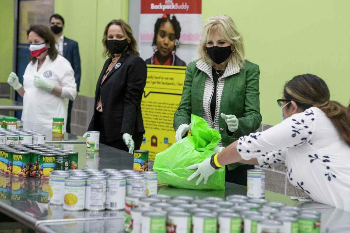 First Lady Jill Biden helps pack a Backpack Buddy bag of food with volunteers at the Houston Food Bank Friday, Feb. 26, 2021 in Houston.