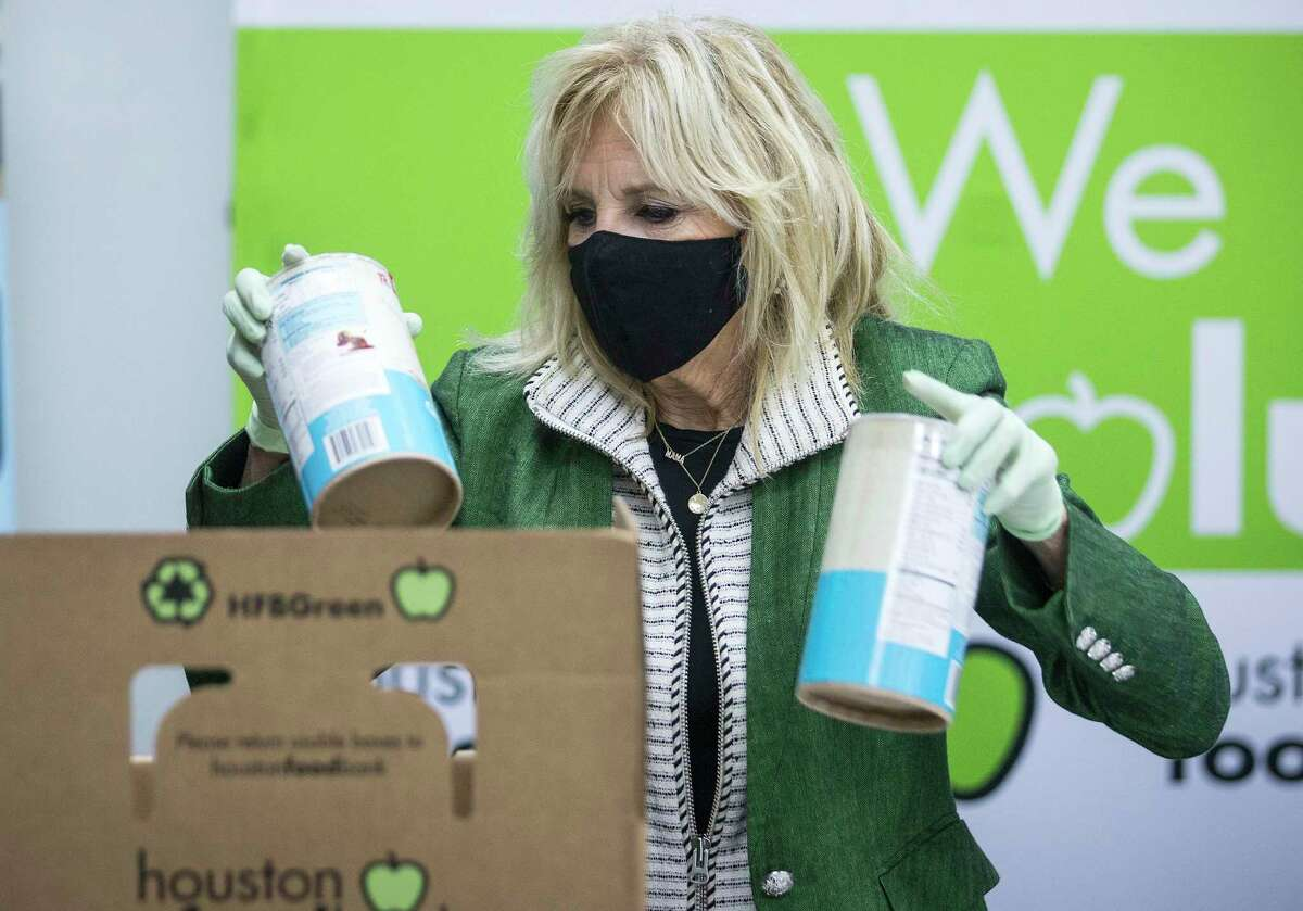 First Lady Jill Biden packs a Senior Box as she helps volunteers at the Houston Food Bank Friday, Feb. 26, 2021 in Houston.