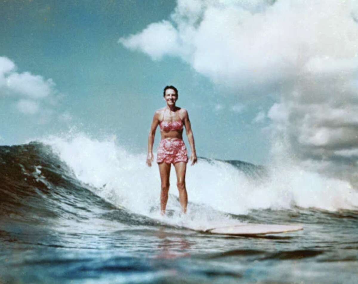 Betty Pembroke Heldreichphotographed surfing at Waikiki in1956. She charted a new path, for herself and for other female surfers, as a champion athlete.
