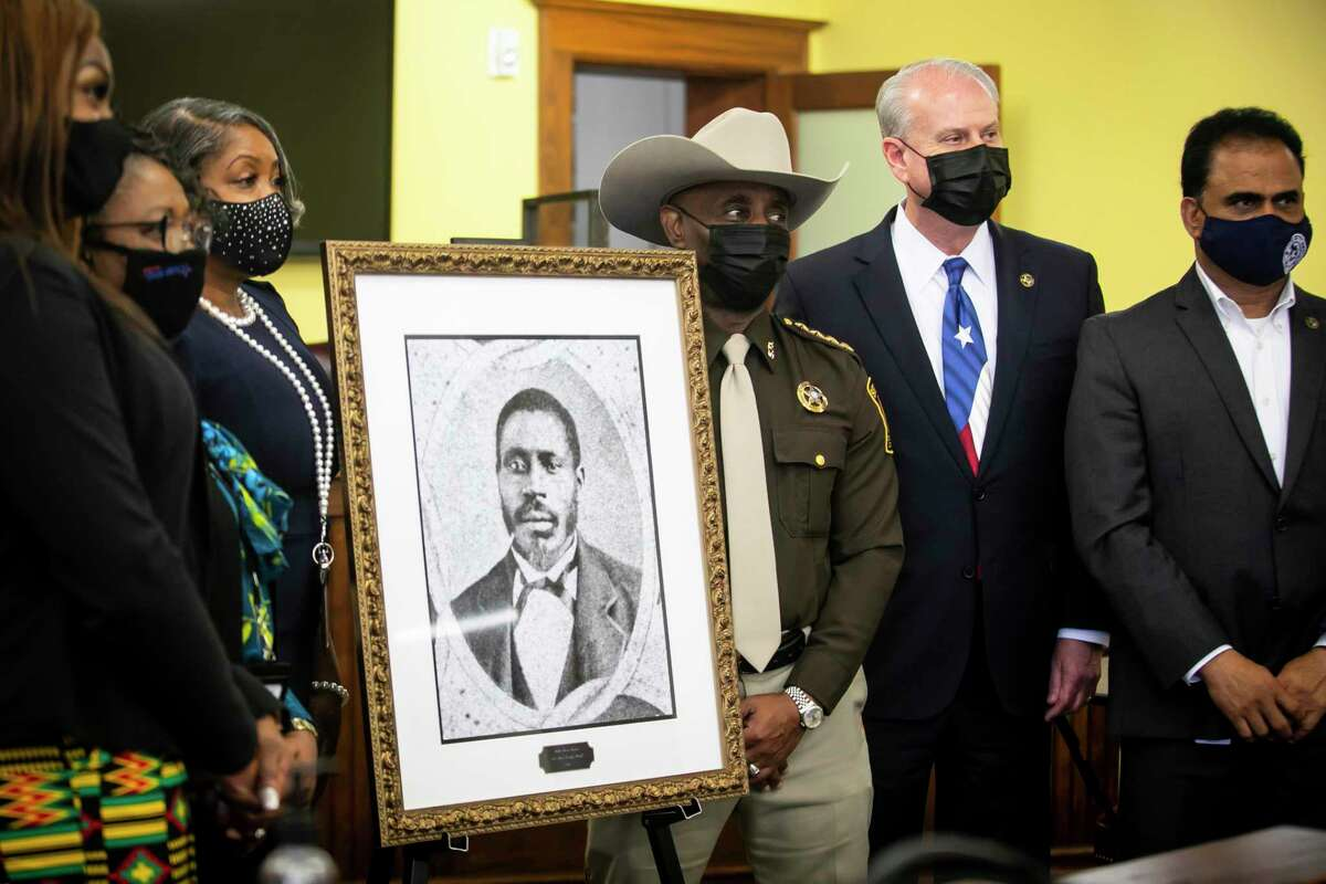County officials unveil a portrait of Walter Moses Burton at The Historic County Courthouse in Richmond on Friday, Feb. 26, 2021.