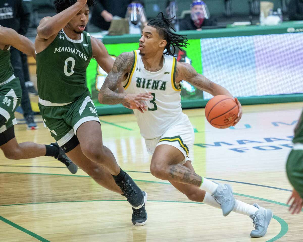 Siena College senior Manny Camperdrives to the basket against Manhattan College junior Warren Williams during a Metro Atlantic Athletic Conference game at the UHY Center on the Siena campus in Loudonville, NY, on Friday, Feb. 26, 2021 (Jim Franco/special to the Times Union.)