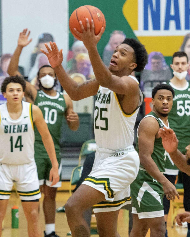 Siena College freshman Aidan Carpenter drives to the basket against Manhattan last season. The Saints' first league game will be against Manhattan this season.