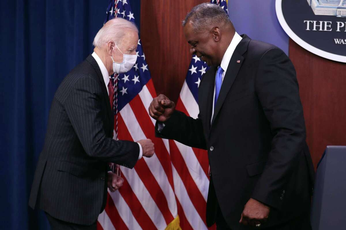 Secretary of Defense Lloyd Austin and President Joe Biden bump fists in greeting at the Pentagon in Arlington, Va., on Wednesday, Feb. 10, 2021. Biden on Wednesday paid tribute to Black Americans serving in the military during his first visit to the Pentagon since taking office, vowing to embrace diversity as a strength at a time of racial reckoning inside the Defense Department. (Oliver Contreras/The New York Times)