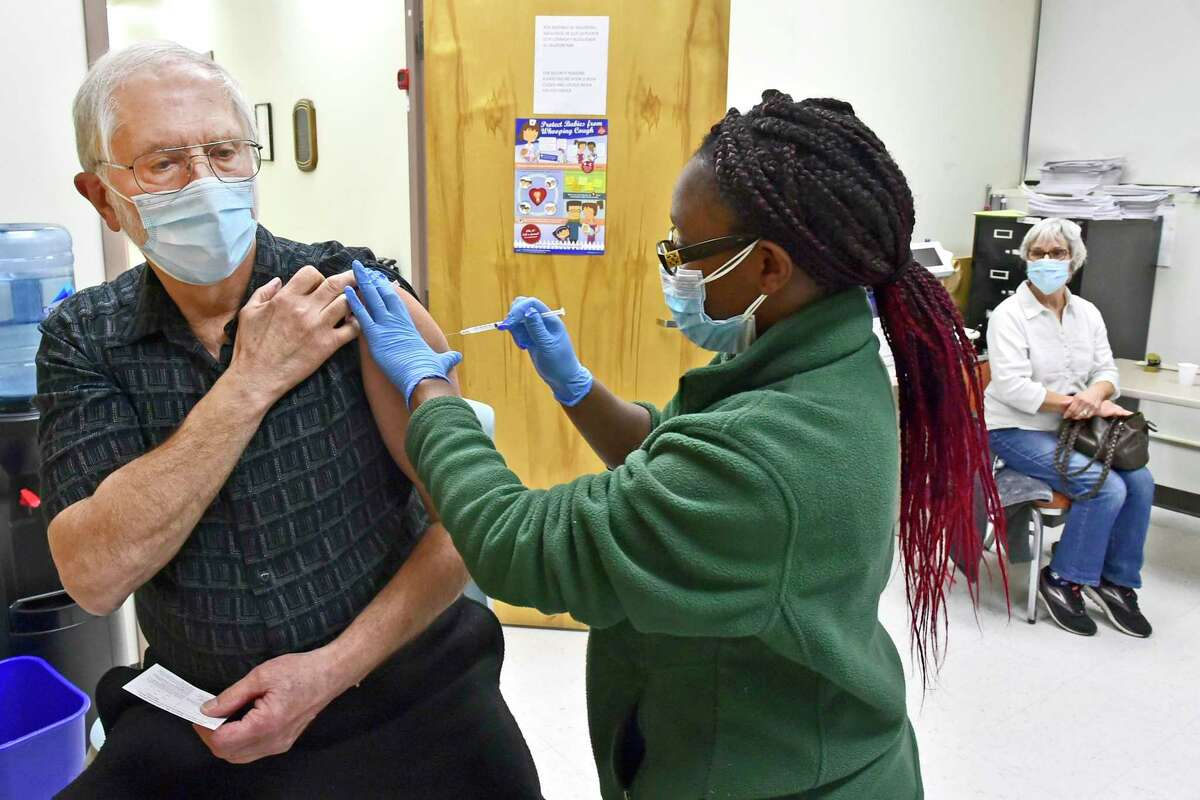 William Stark, 72, of Wallingford, left, gets a Covid-19 vaccination from public health nurse Leshawna Murrell, at the New Haven Public Health Department on Meadow Street, February 26, 2021, as his wife, Patricia Stark, 69, of Wallingford, right, waits for her turn for the vaccination. Medical assistants also want to give vaccines during the pandemic.