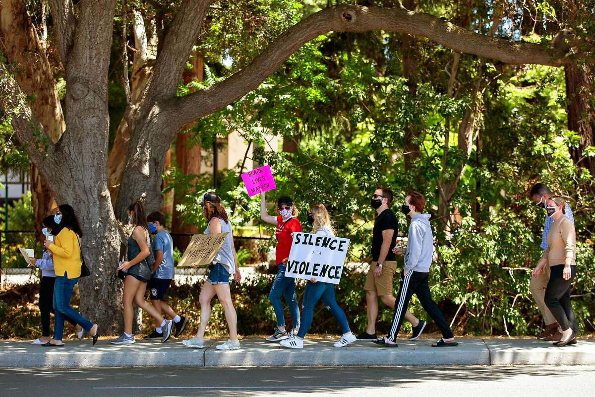 Saint Francis High School students and parents and local community members march down Miramonte Avenue in Mountain View on June 8, 2020.