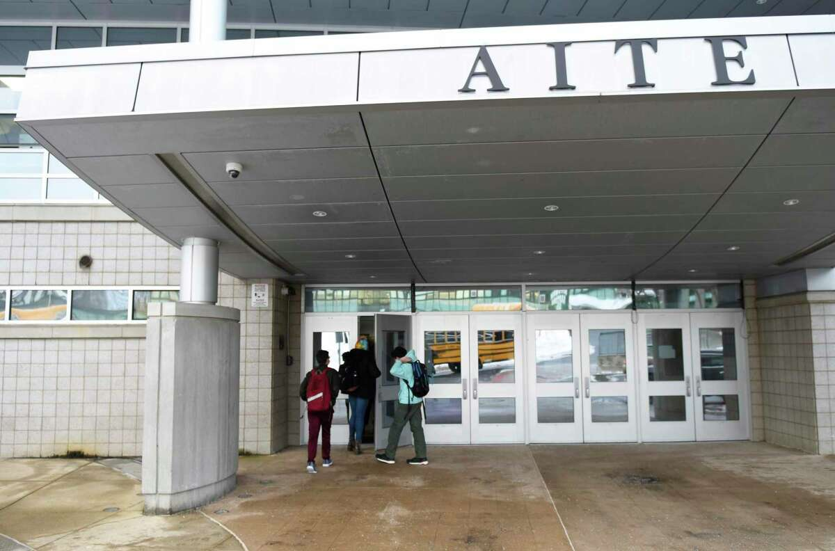 Students enter the Academy of Information Technology & Engineering (AITE) in Stamford, Conn. Tuesday, Feb. 23, 2021.