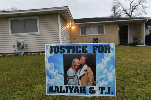 John Gradnigo, Jr, and wife Amanda have signs posted in the front yard of their Orange home, where daughter Aaliyah and boyfriend T.J. Livings were shot and killed over a month ago. The investigation is ongoing, complicated by cross-state line efforts to bring a suspect into custody. Photo made Thursday, February 25, 2021 Kim Brent/The Enterprise