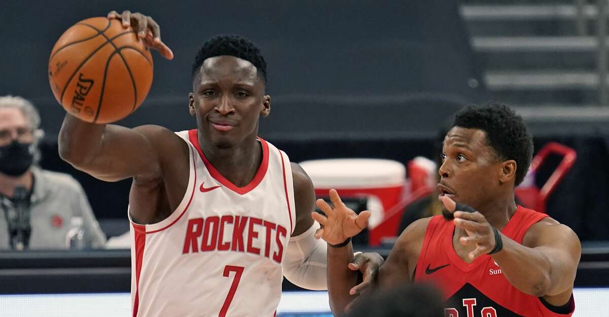 Houston Rockets guard Victor Oladipo (7, left) loses control of the ball in front of Toronto Raptors guard Kyle Lowry during the first half of an NBA basketball game Friday, Feb. 26, 2021, in Tampa, Fla. (AP Photo/Chris O'Meara)