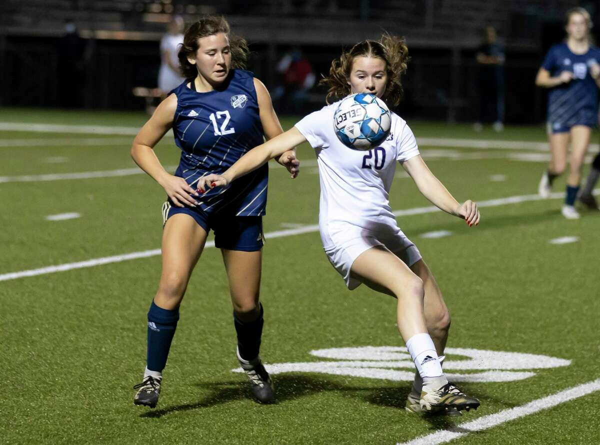 Montgomery fowrard Ashlee Stollje (20) and Lake Creek Kate Coleman (12) fight for control of the ball during the first half of a District 20-5A girls soccer game at Lake Creek High School, Friday, Feb. 26, 2021, in Montgomery.