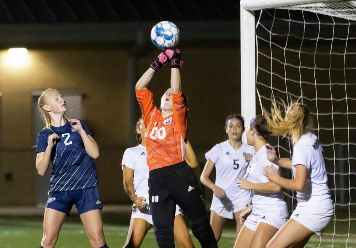 Montgomery goal keeper Kailea Oliver (00) intercepts a kick during the first half of a District 20-5A girls soccer game against Lake Creek at Lake Creek High School, Friday, Feb. 26, 2021, in Montgomery.