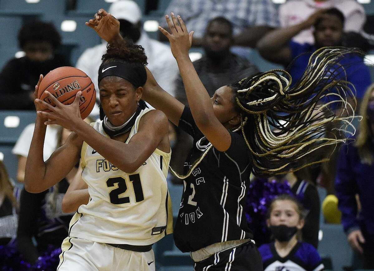 Foster's Kaiya Wynn (21) grabs a rebound from College Station's Jayden Davenport during the second half of a 5A Region III semifinal high school basketball playoff game, Friday, Feb. 26, 2021, in Katy, TX.