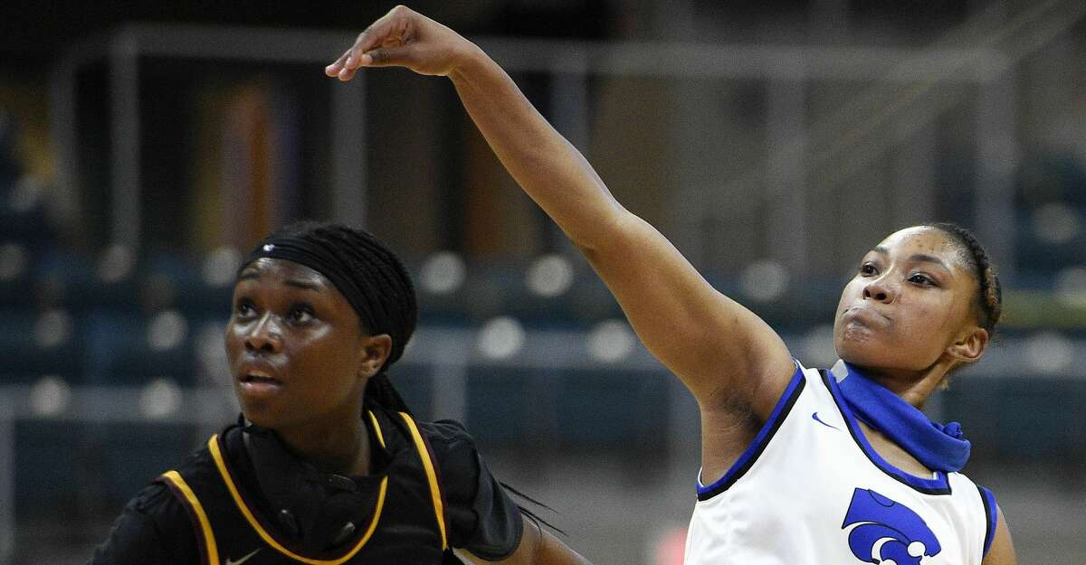 Cypress Creek guard Kyndall Hunter (22) watches her three point basket as Summer Creek guard Adaora Nwokeji defends during the first half of a 6A Region III semifinal high school basketball playoff game, Friday, Feb. 26, 2021, in Katy, TX.