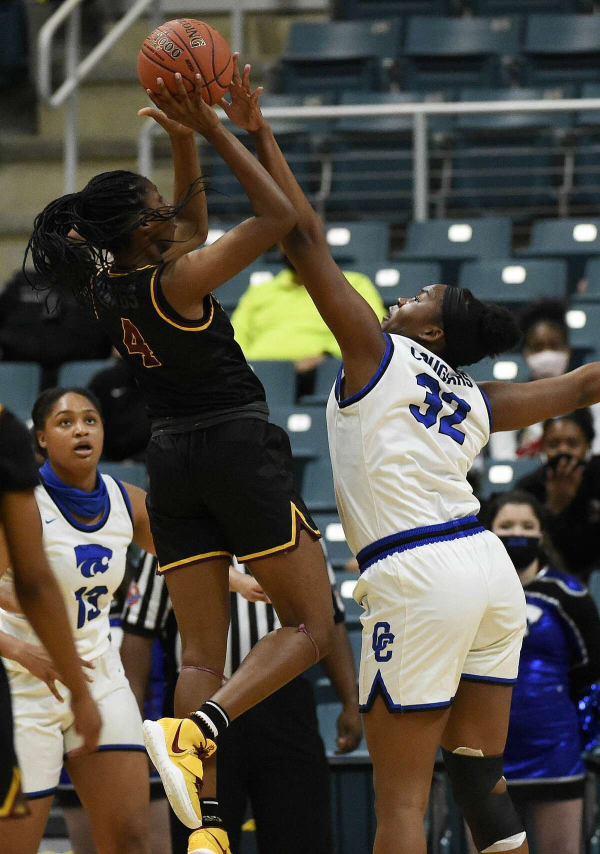 Summer Creek forward Kaitlyn Duhon (4) shoots as Cypress Creek center Taylor Jackson defends during the first half of a 6A Region III semifinal high school basketball playoff game, Friday, Feb. 26, 2021, in Katy, TX.