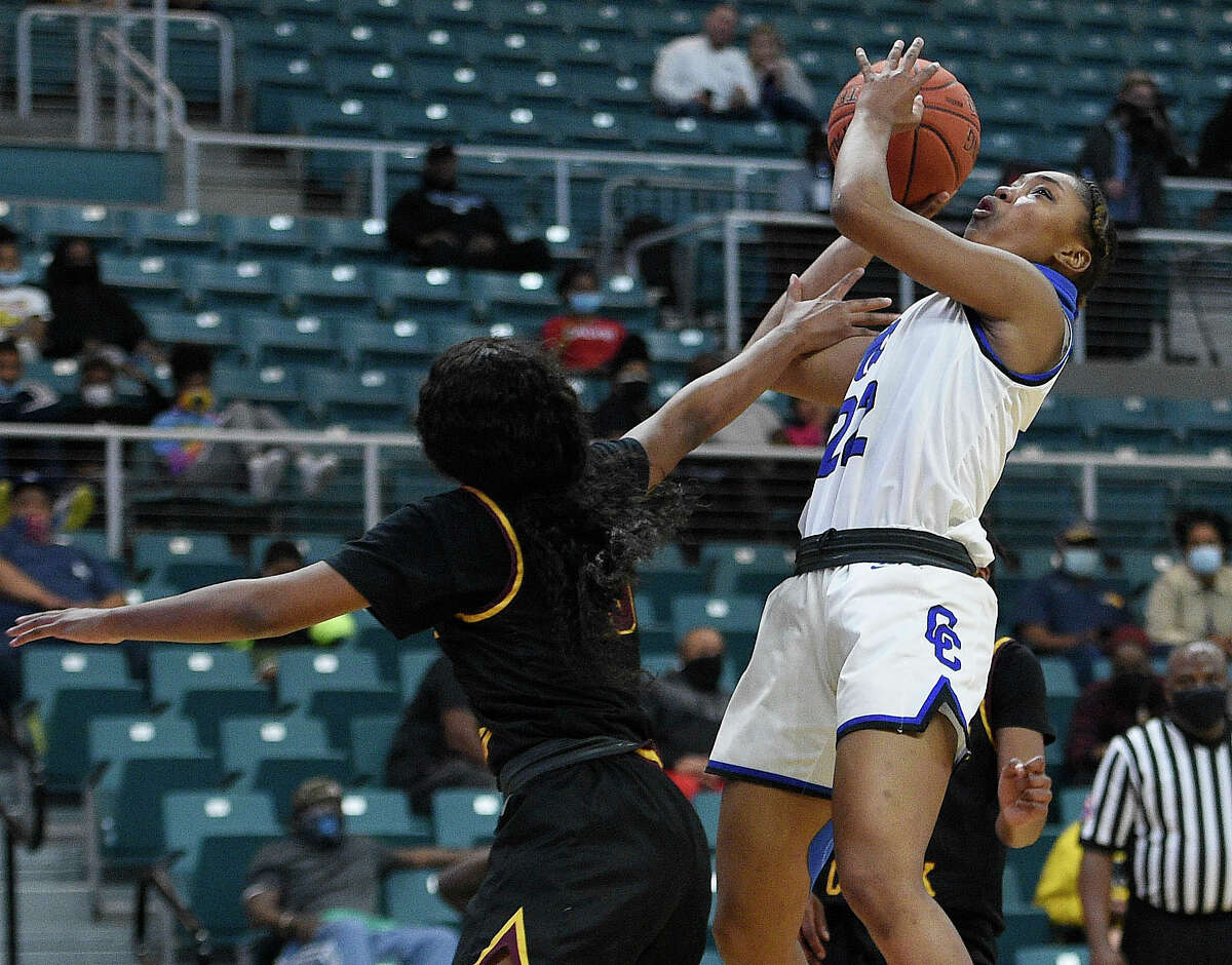 Cypress Creek guard Kyndall Hunter, right, shoots as Summer Creek forward Tianna Rhodes defends during the second half of a 6A Region III semifinal high school basketball playoff game, Friday, Feb. 26, 2021, in Katy, TX.