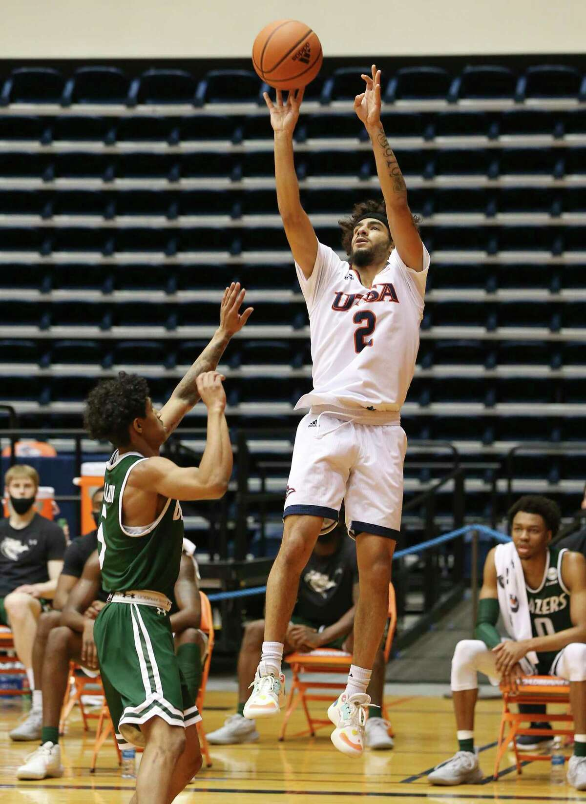 UTSA's Jhivvan Jackson (02) shoots over University of Alabama Birmingham's Jalen Benjamin (05) during men's basketball at the Convocation Center on Friday, Feb. 26, 2021. UTSA goes down, 57-64, to UAB and will play again on Saturday.