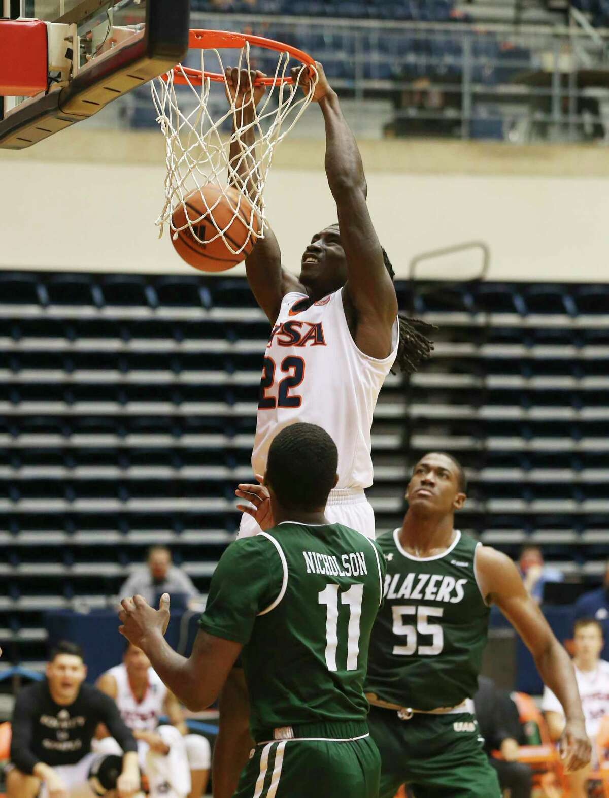 UTSA's Keaton Wallace (22) dunks University of Alabama Birmingham's Kassim Nicholson (11) during men's basketball at the Convocation Center on Friday, Feb. 26, 2021. UTSA goes down, 57-64, to UAB and will play again on Saturday.