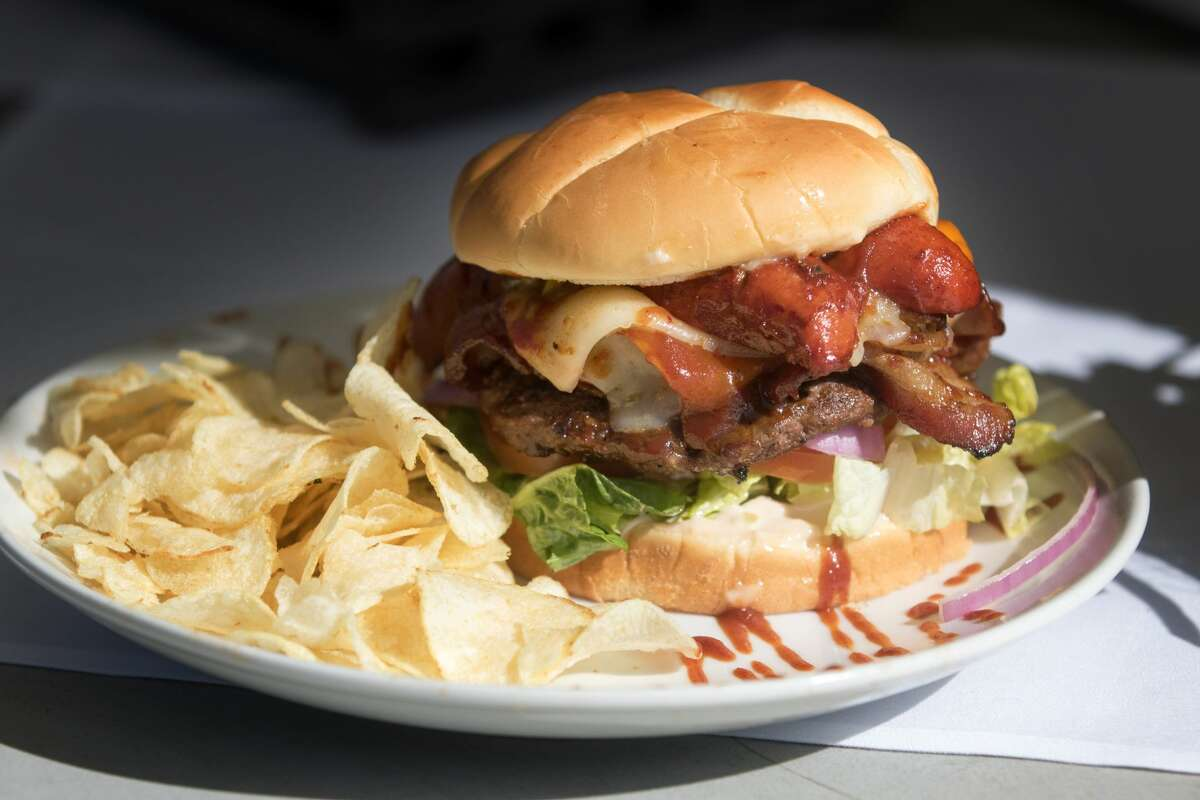 """The """"Carlotta Burger"""" is the speciality burger of the Hill House burger stand at the Lake Chabot Golf Course in Oakland, Calif. on Feb. 26, 2021. Its the creation of Carlotta Brown, the cook and hospitality queen who runs the stand."""