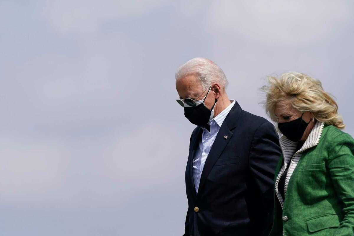 President Joe Biden and first lady Jill Biden step off Air Force One at Ellington Field Joint Reserve Base in Houston, Friday, Feb. 26, 2021. (AP Photo/Patrick Semansky)