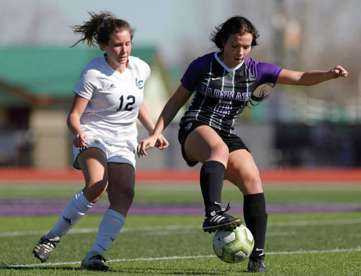 FILE - Willis' Lucy Smith (18) controls the ball in front of Lake Creek's Kate Coleman (12) in the second period of a match during the Kat Cup girls soccer tournament at Berton A. Yates Stadium, Thursday, Jan. 14, 2021, in Willis.