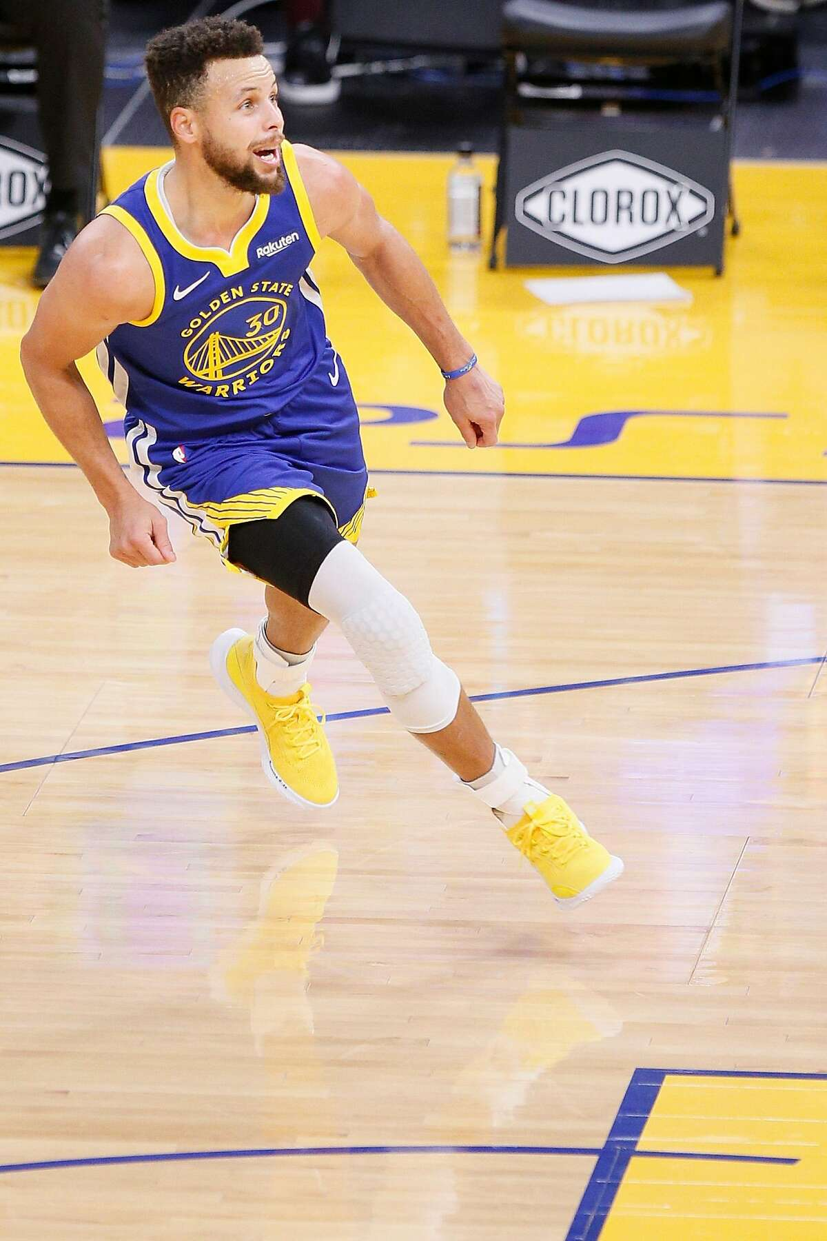 Golden State Warriors guard Stephen Curry (30) reacts after his half court shot nearly went in to end the third quarter of an NBA game against the Charlotte Hornets at Chase Center, Friday, Feb. 26, 2021, in San Francisco, Calif.