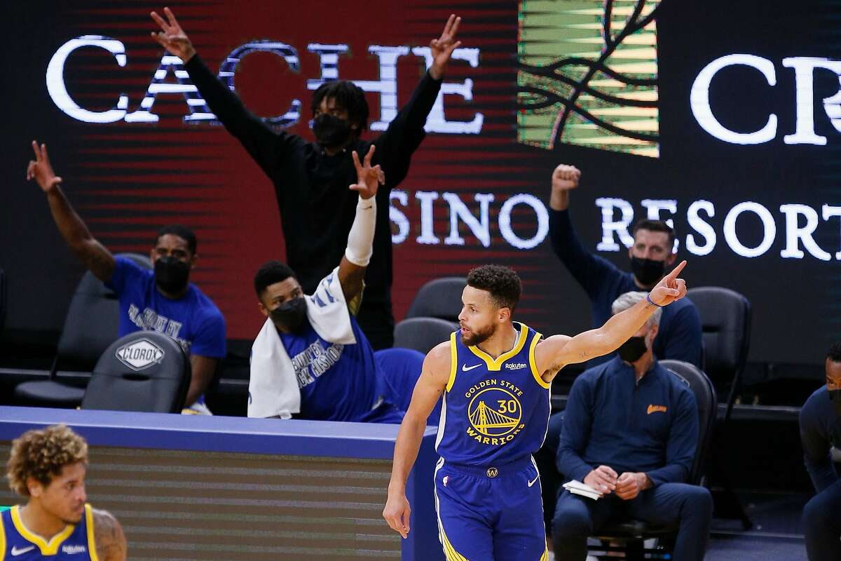 Golden State Warriors guard Stephen Curry (30) scores a three-point field goal in the final moments of the second quarter against the Charlotte Hornets in an NBA game at Chase Center, Friday, Feb. 26, 2021, in San Francisco, Calif.