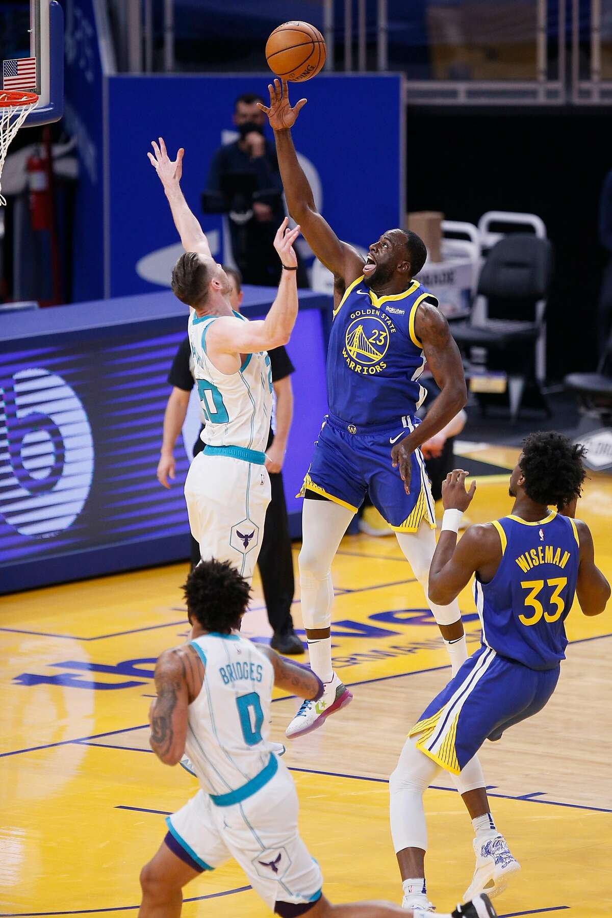 Golden State Warriors forward Draymond Green (23) scores on a layup against Charlotte Hornets forward Gordon Hayward (20) in the first quarter of an NBA game at Chase Center, Friday, Feb. 26, 2021, in San Francisco, Calif.