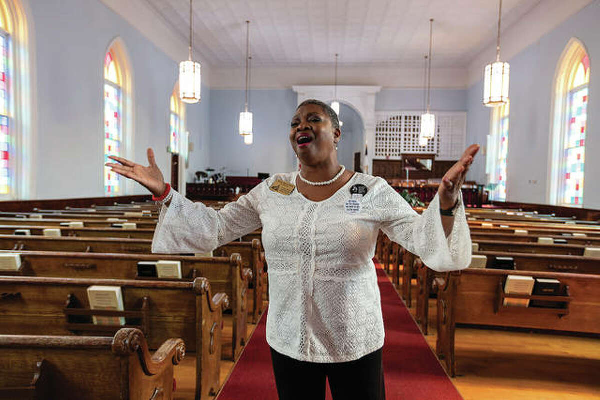 Wanda Howard Battle, tour director at the church where Dr. Martin Luther King Jr. once preached, sings while giving tours and teaching about King's legacy.