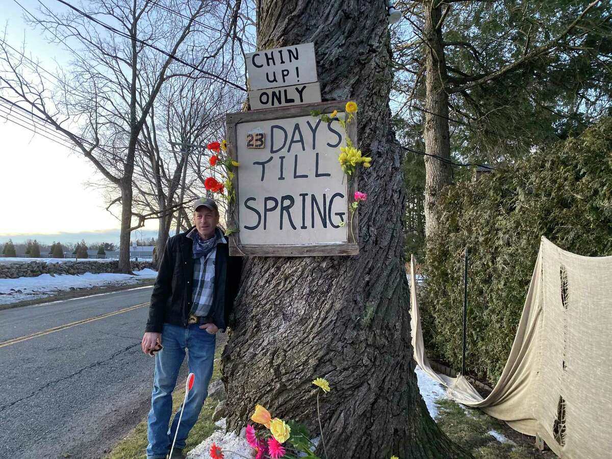 The keeper of the spring sign, Joe Haberny, changes the number of days left until spring in the early morning hours each day. Haberny has been the caretaker at the Middlesex Road home for over 30 years, and has been maintaining the sign for nearly two decades.