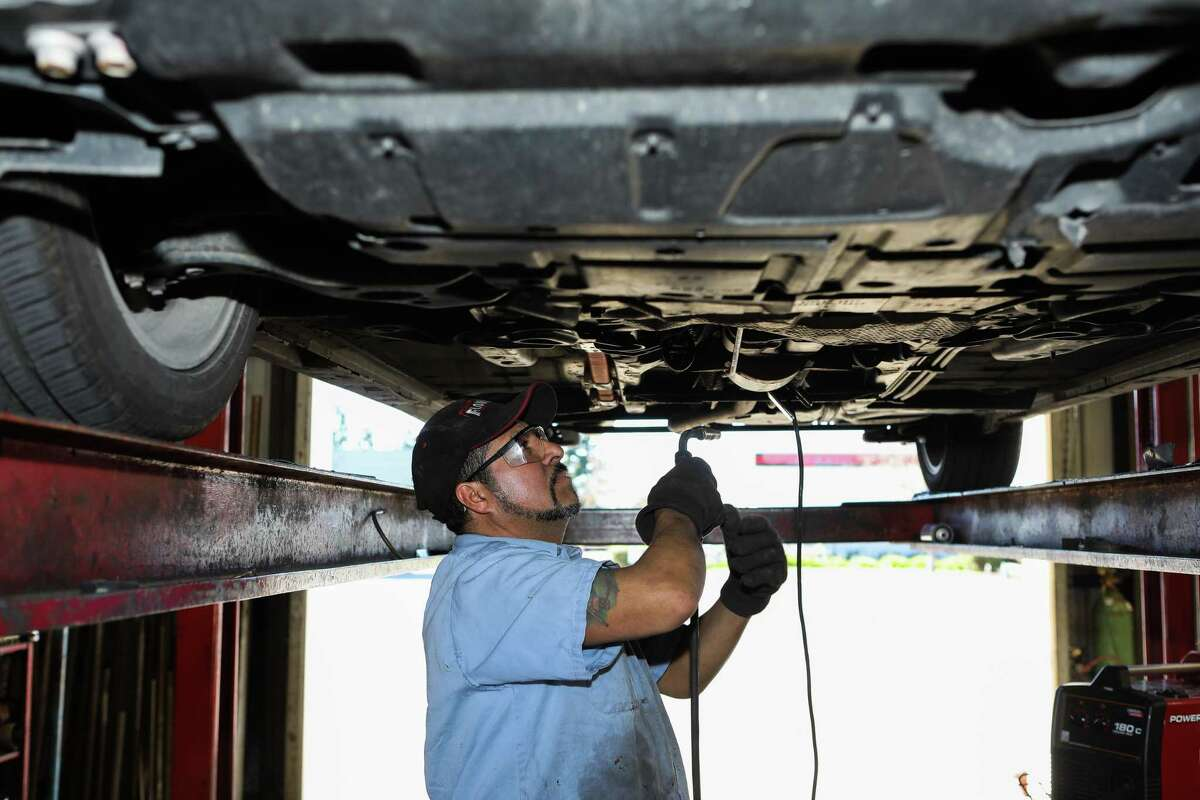 Alberto Pachuca, a mechanic, builds a protective cage for a catalytic converter in a Toyota Prius at Johnny Franklin Muffler on Wednesday, January 24, 2021, in Santa Rosa , Calif.