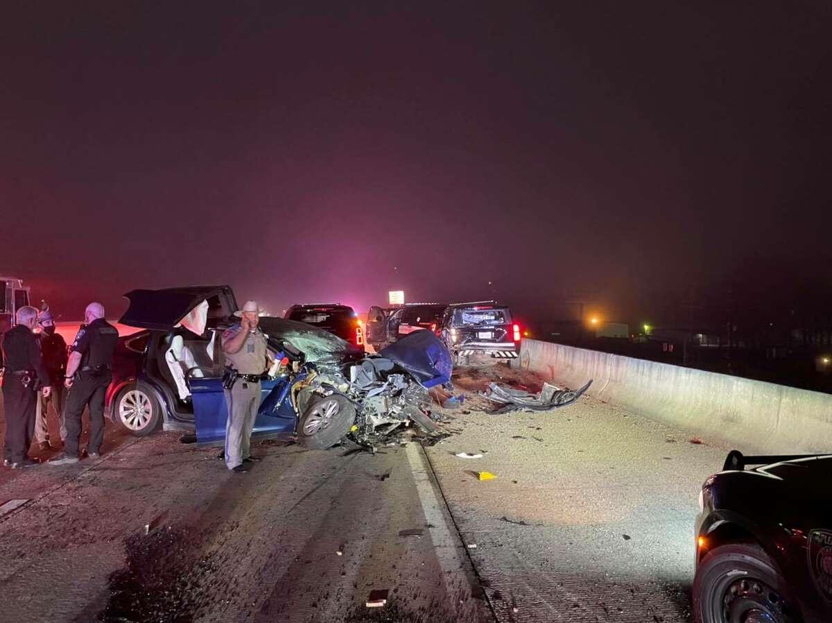 A driver struck parked patrol cars.