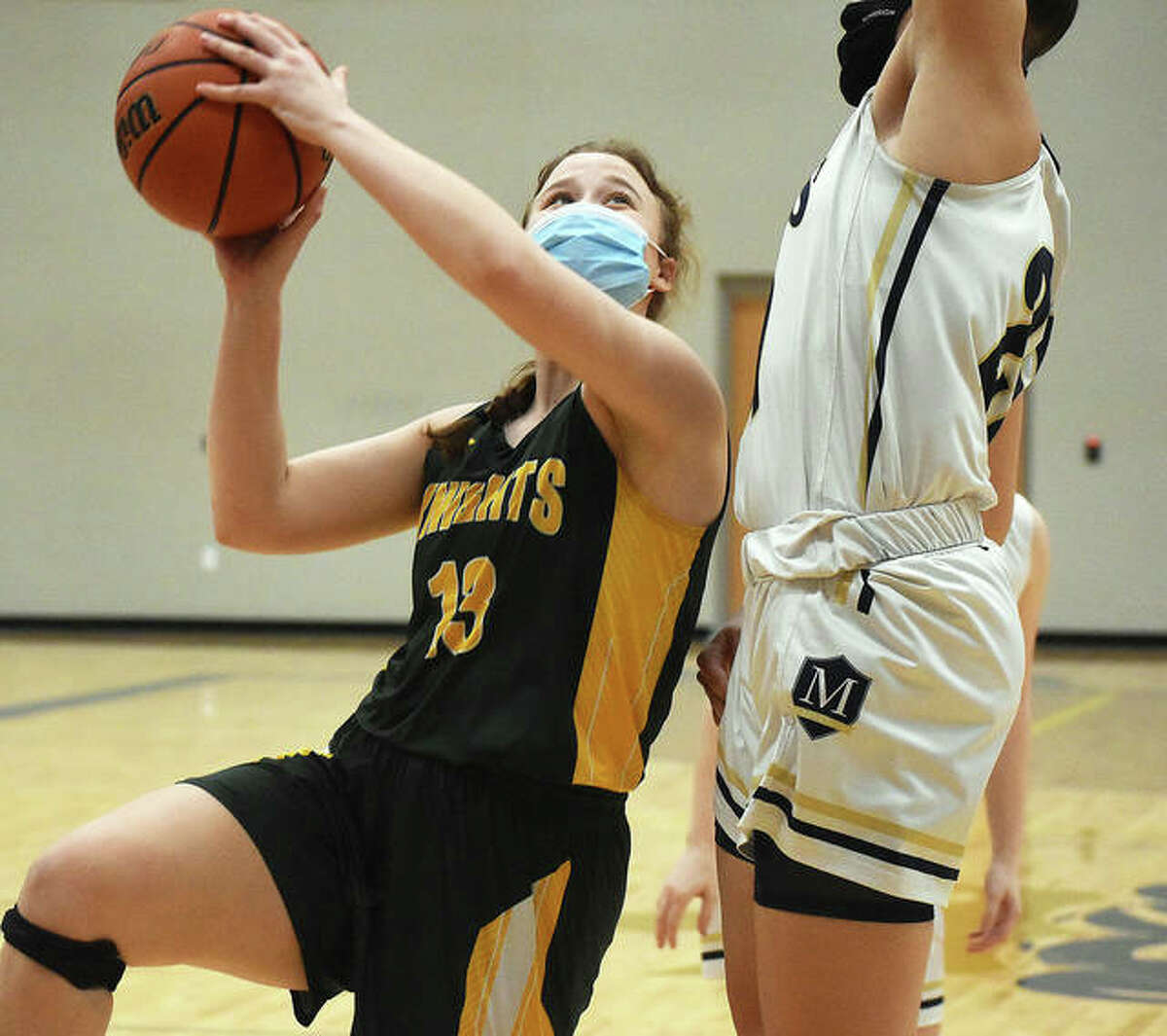 Metro-East Lutheran forward Caitlin Reynolds puts up a contested shot in the first quarter of Friday's game against Maryville Christian.