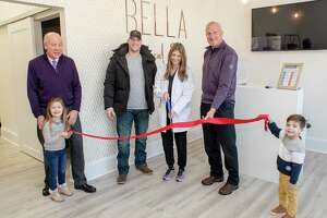 Dr. Daniela Convertito cuts the ribbon at the grand opening of her Bella Medical Spa on Bridgeport Avenue in Shelton. Pictured with Convertito are, left to right, her daughter, Alexandra, Greater Valley Chamber of Commerce President Bill Purcell, her husband, Brian, Mayor Mark Lauretti and her son, Mateo.