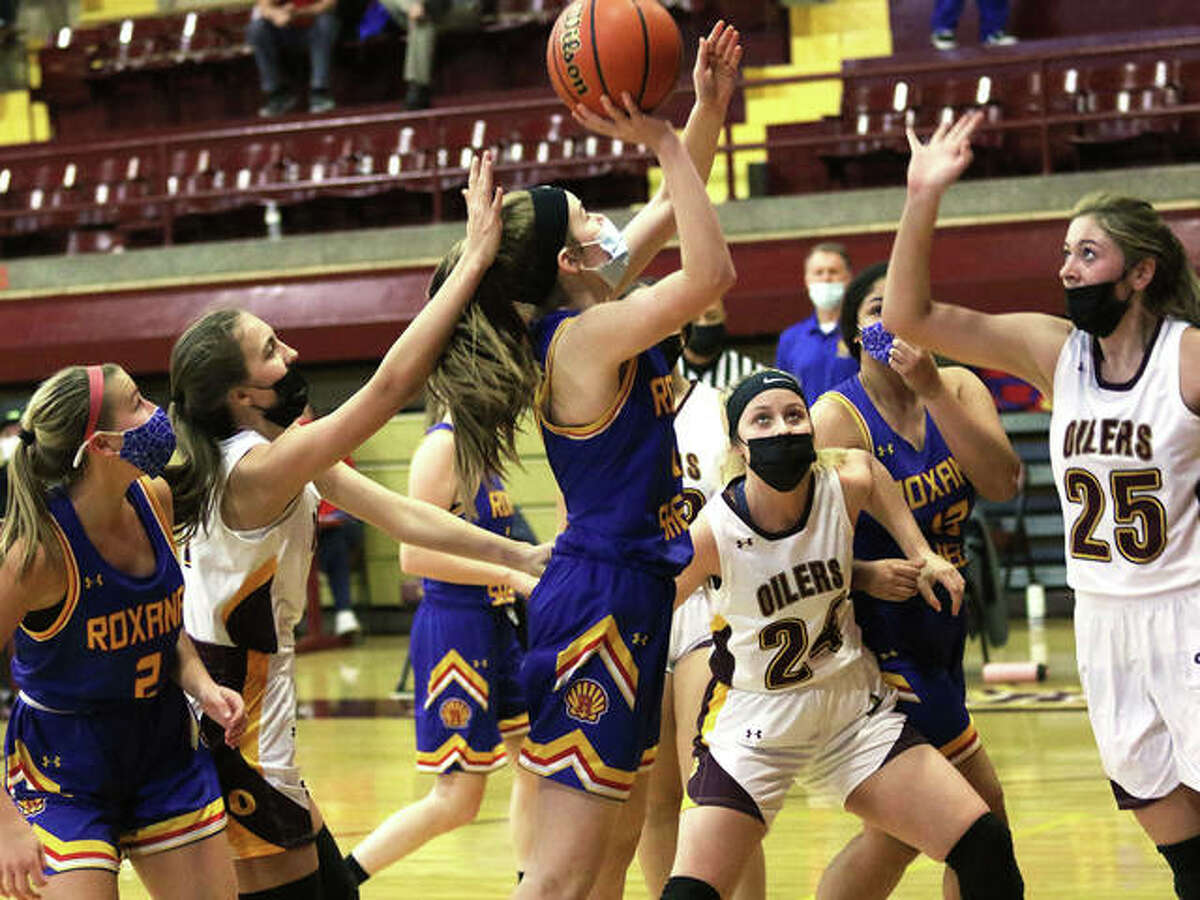 Roxana's Abbie Gehrs puts up a shot in traffic against EA-WR in a Feb. 6 game in Wood River. On Friday night in Carlinville, the Shells ended a 30-game losing streak in South Central Conference play by beating the Cavaliers.