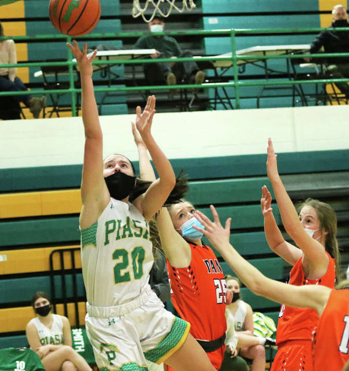 Southwestern's Korrie Hopkins (20), shown scoring against Pana in a Feb. 19 game in Piasa, scored 23 points on Friday night to lead the Piasa Birds to a SCC victory in Greenville.