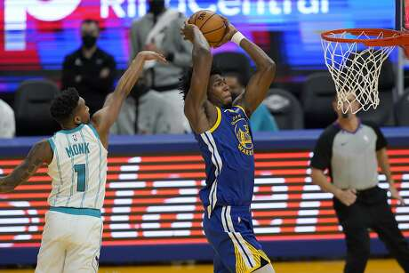 Golden State Warriors center James Wiseman, front right, dunks against Charlotte Hornets guard Malik Monk (1) during the second half of an NBA basketball game in San Francisco, Friday, Feb. 26, 2021. (AP Photo/Jeff Chiu)