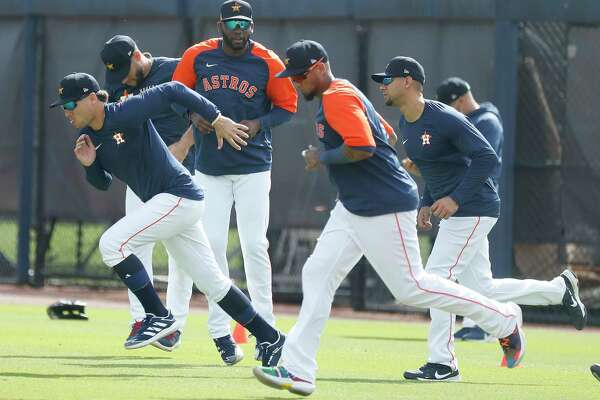 Houston Astros Yordan Alvarez warms up with teammates during spring training workouts for the Astros at Ballpark of the Palm Beaches in West Palm Beach, Florida, Saturday, February 27, 2021.