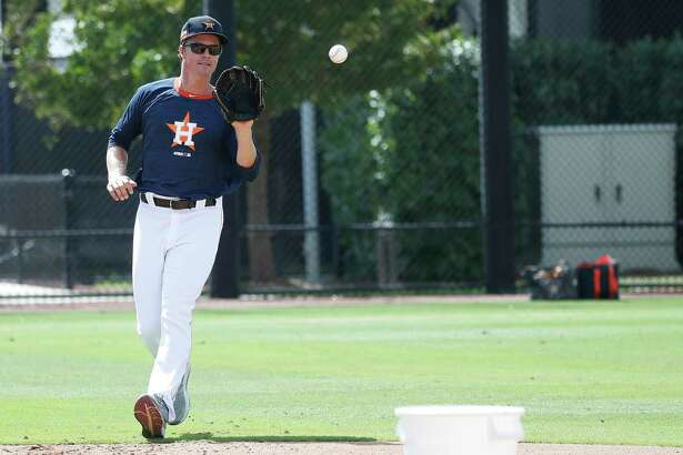 Houston Astros pitcher Zack Greinke participates in PFP's during spring training workouts for the Astros at Ballpark of the Palm Beaches in West Palm Beach, Florida, Saturday, February 27, 2021.