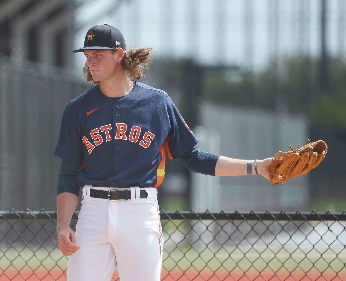 Houston Astros pitcher Forrest Whitley (61) pitches a bullpen session during spring training workouts for the Astros at Ballpark of the Palm Beaches in West Palm Beach, Florida, Saturday, February 27, 2021.