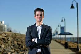 State Senate candidate Joshua Esses poses in the Harbor Point section of Stamford, Conn. Thursday, Feb. 25, 2021.