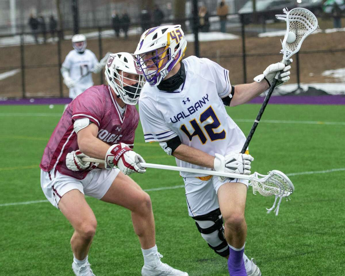 UAlbany senior Peter Schwab tries to get by Colgate University junior Will Sidari during the season opener at John Fallon Field on the UAlbany campus in Albany, NY, on Saturday, Feb. 27, 2021 (Jim Franco/special to the Times Union.)