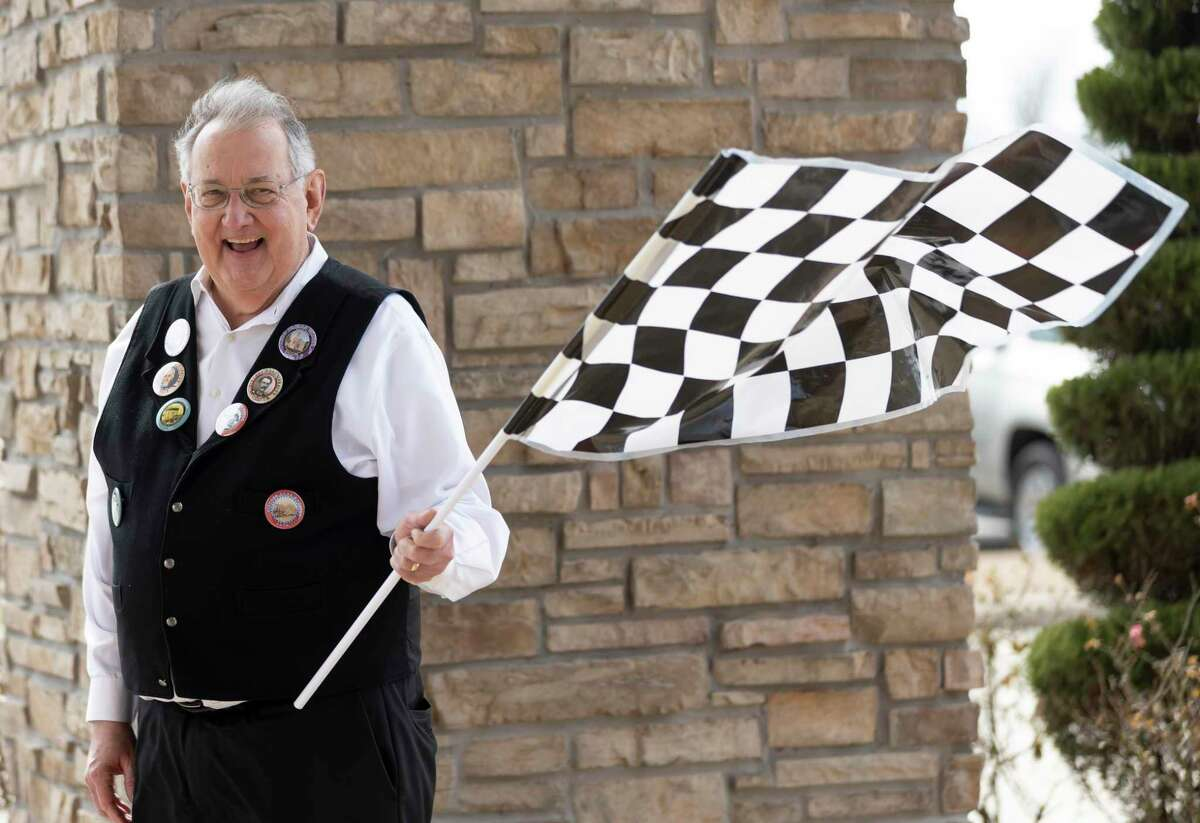 Montgomery County Historical Commission chair, Larry Foerster, waves a flag once teams take off during the 8th Annual History Road Rally starting at the North Montgomery County Community Center, Saturday, Feb. 27, 2021, in Willis. Teams will collect clues across North Montgomery County and the first team to return to the community center with the correct answers within 2 hours wins.