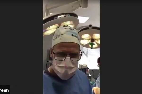 A screen grab of Scott Green joining a traffic court Zoom appearance while performing surgery.