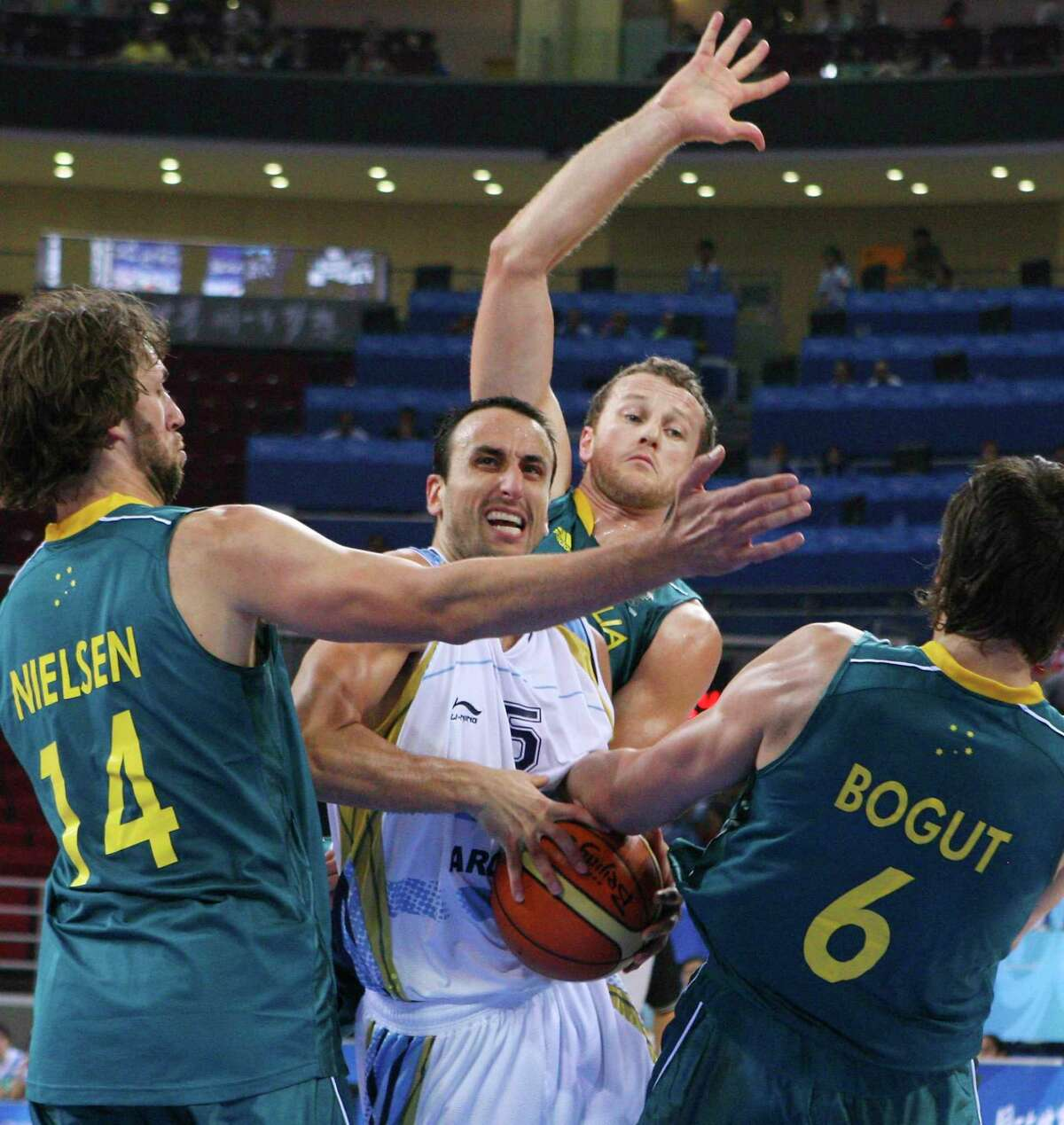 FOR SPORTS - Argentina's Manu Ginobili looks for room between Australia's Matt Nielsen (from left) Glen Saville and Andrew Bogut during first half action at the 2008 Beijing Olympics Tuesday Aug 12, 2008 in Beijing, China. (PHOTO BY EDWARD A. ORNELAS/eornelas@express-news.net)
