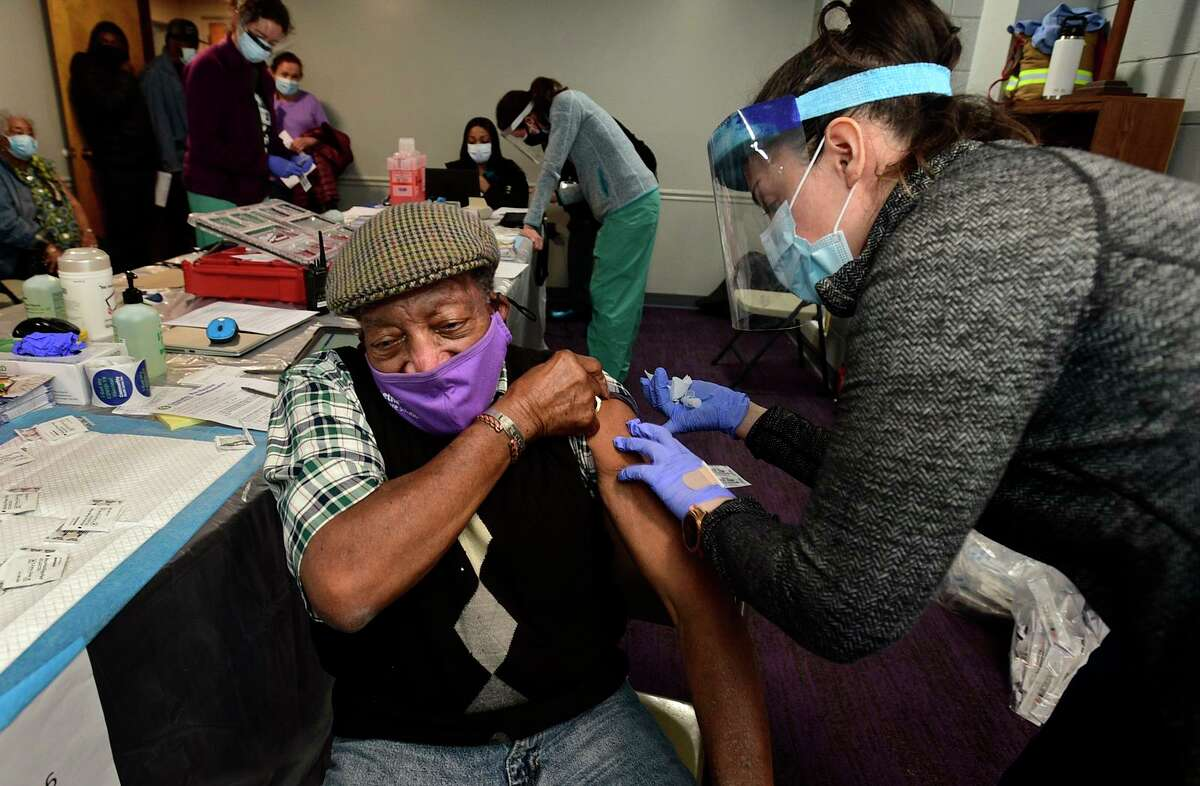 Stamford residents including Jesse Mercer receive their shot during pop-up clinic for COVID-19 vaccination Saturday, February 27, 2021 for first and second doses at the Bethel AME Church in Stamford, Conn. This clinic is set up to support vaccination within communities of color and for those who do not have the ability to make appointments online. The clinic will be held again on March 27 (10am-3pm).