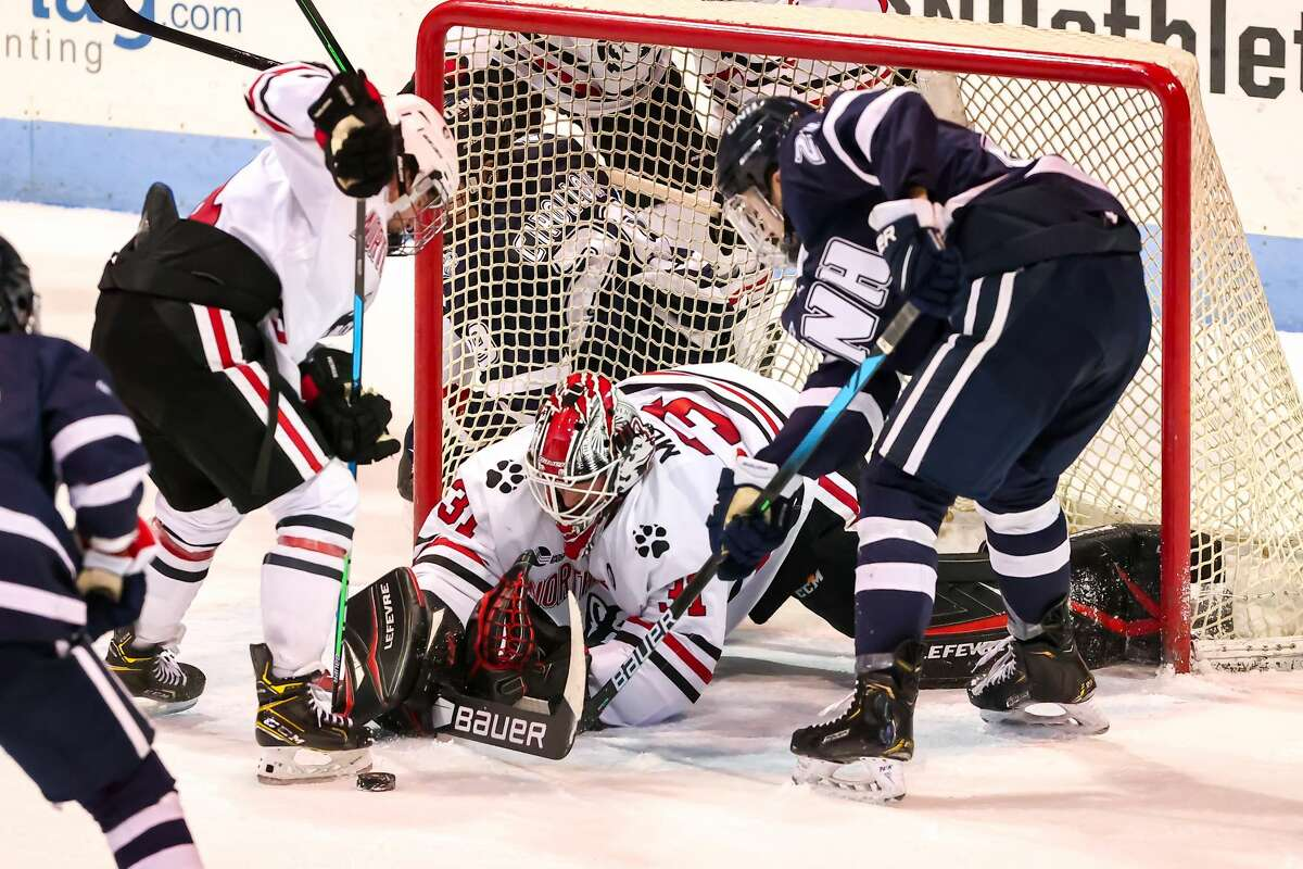 Hudson Falls High graduate Connor Murphy, goalie of the Northeastern hockey team, makes a save for the 18th-ranked team.