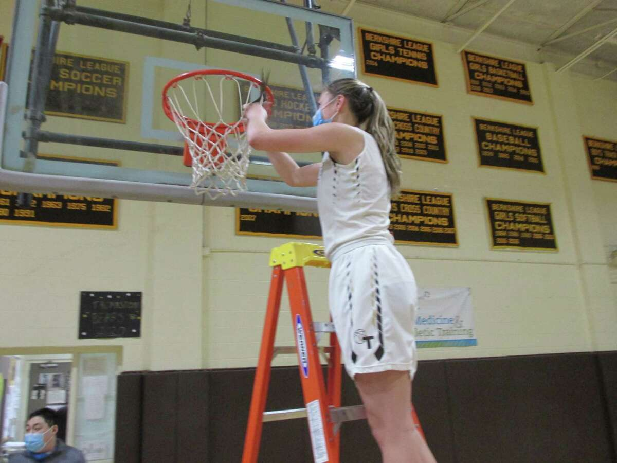 Thomaston high scorer Emma Kahn cuts down her piece of the BL Championship net after the Bears' win over Northwestern Saturday afternoon.