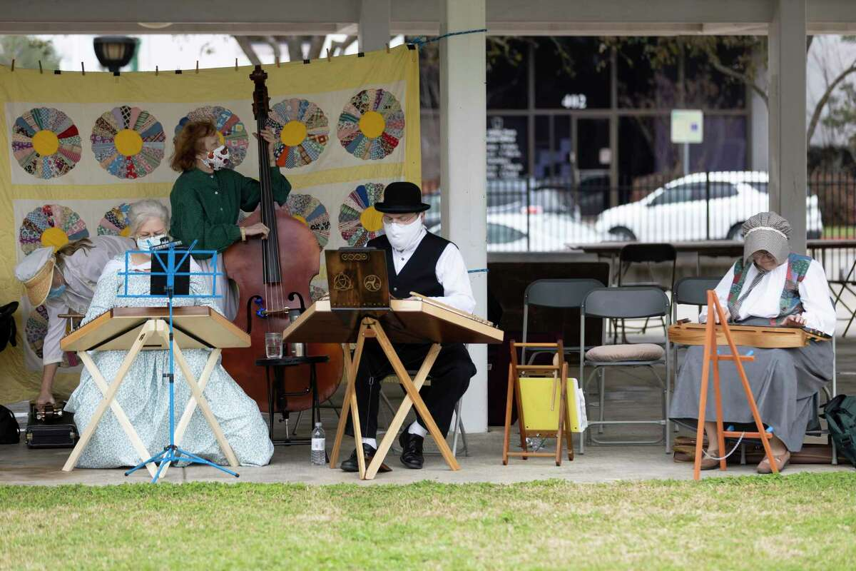 The North Harris Dulcimer Society performs during the Texas Independence Celebration at Heritage Park, Saturday, Feb. 27, 2021, in Conroe. The annual event featured historical music, cotton spindle demonstrations and a wide variety of vendors.